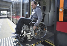 A man in a wheelchair leaves the ultra-low-floor tram using the ramp